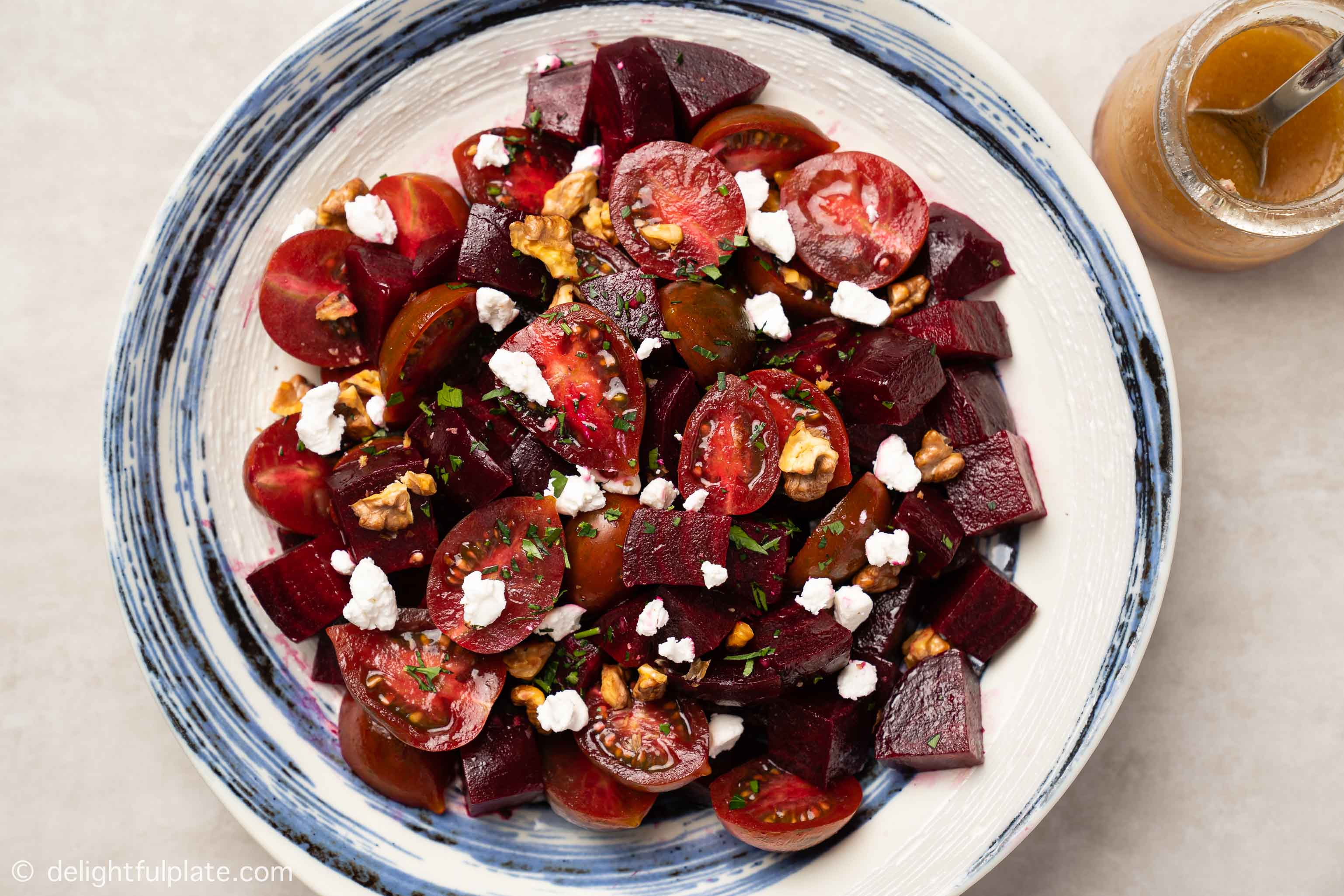 a plate of Roasted Beetroot Salad with Goat Cheese, Walnut and Cherry Tomato