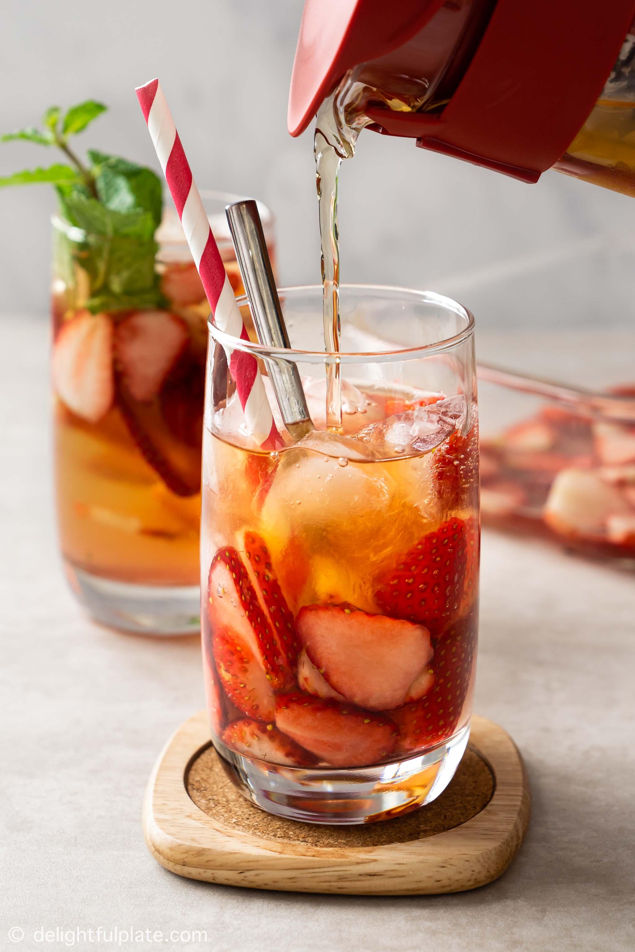 a glass of strawberry sweet tea