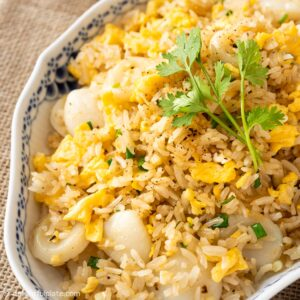 a plate of scallop fried rice