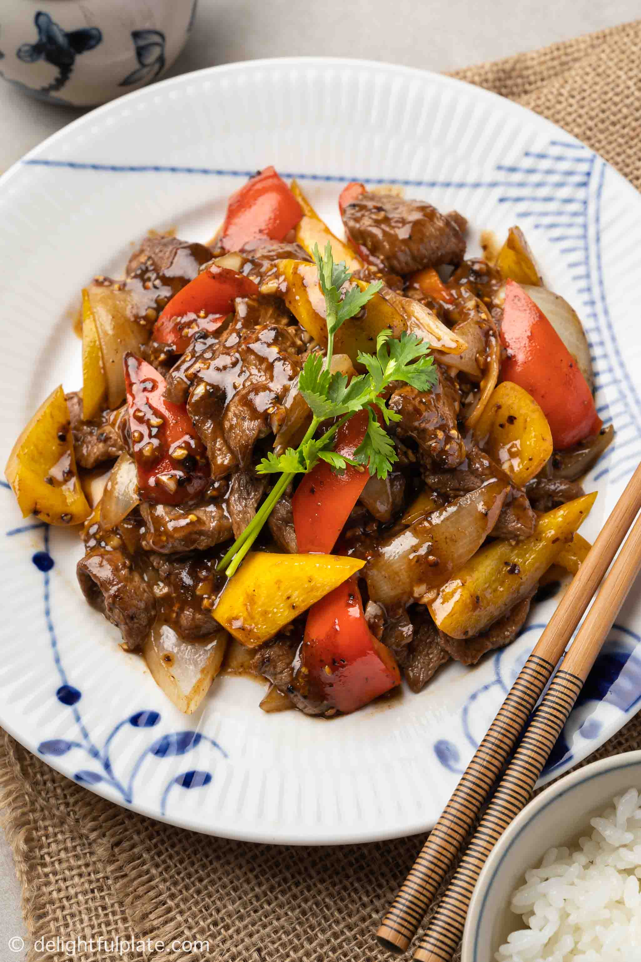 a plate of beef in black pepper sauce