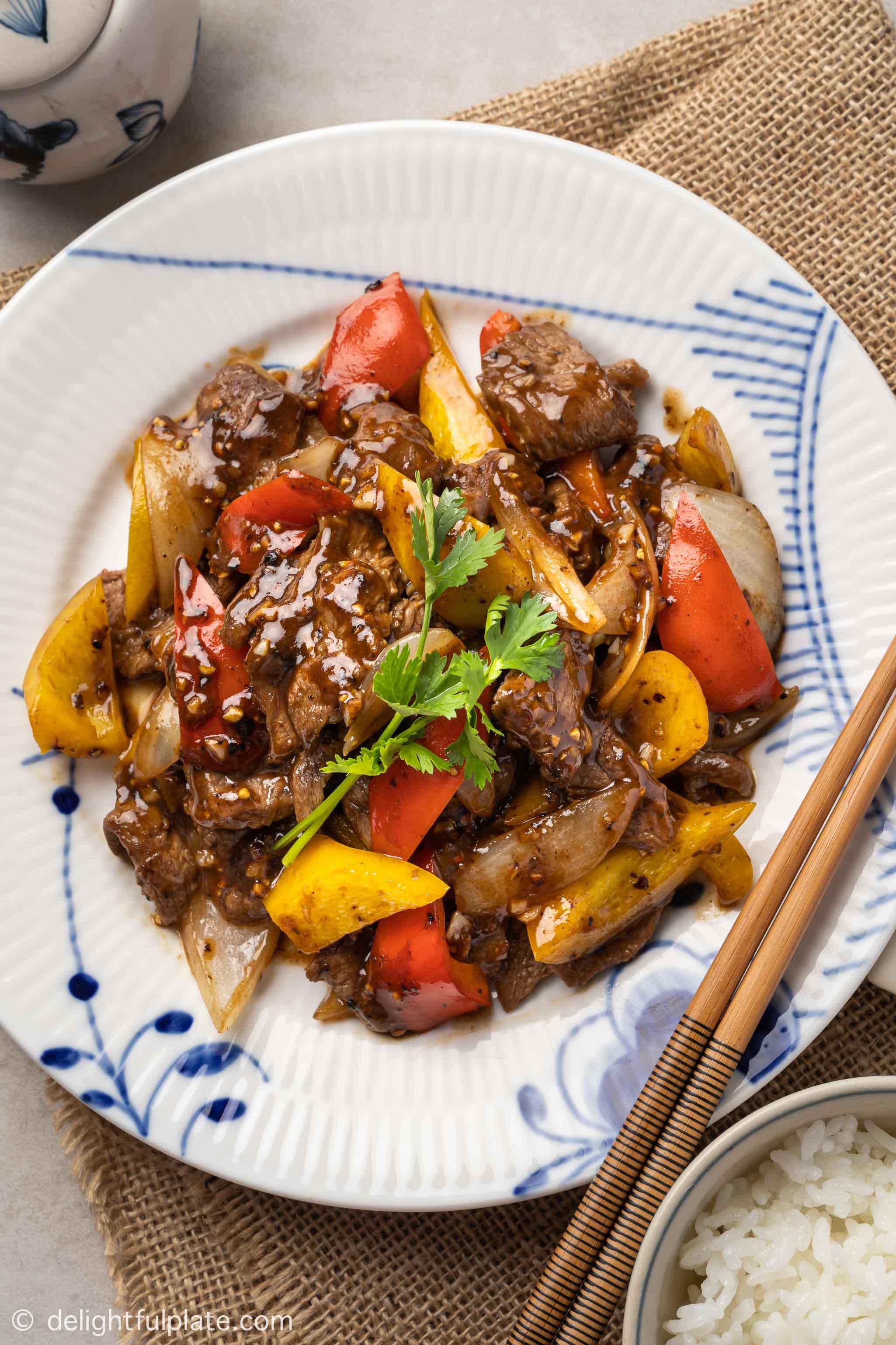 a plate of black pepper beef stir-fry