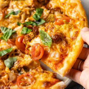 a slice of paprika chicken pizza