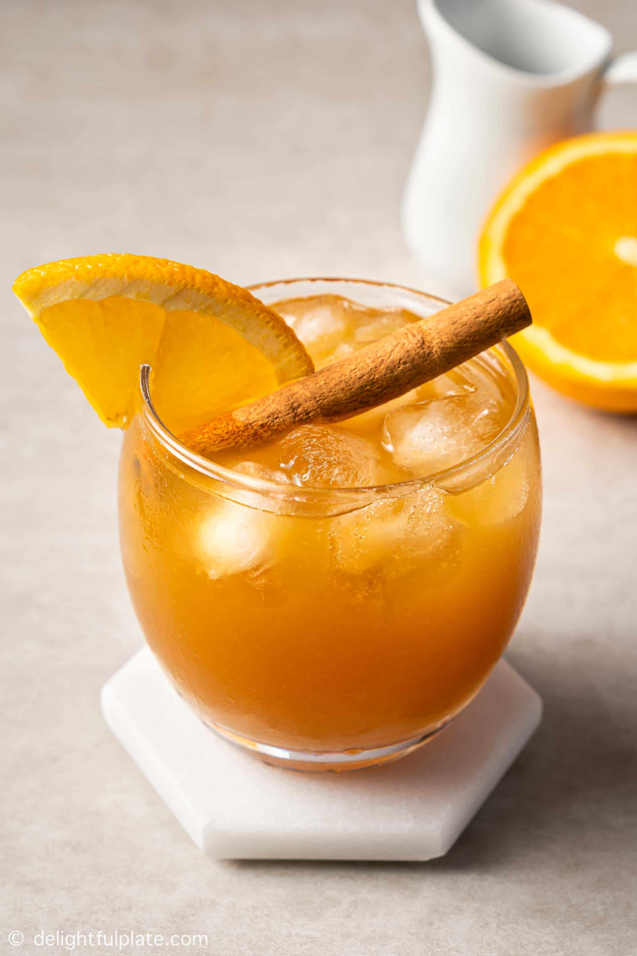 a glass of orange cinnamon iced tea