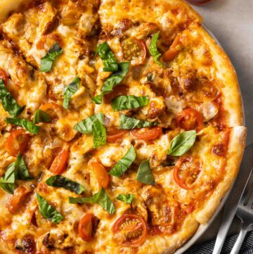 a paprika chicken pizza on a plate