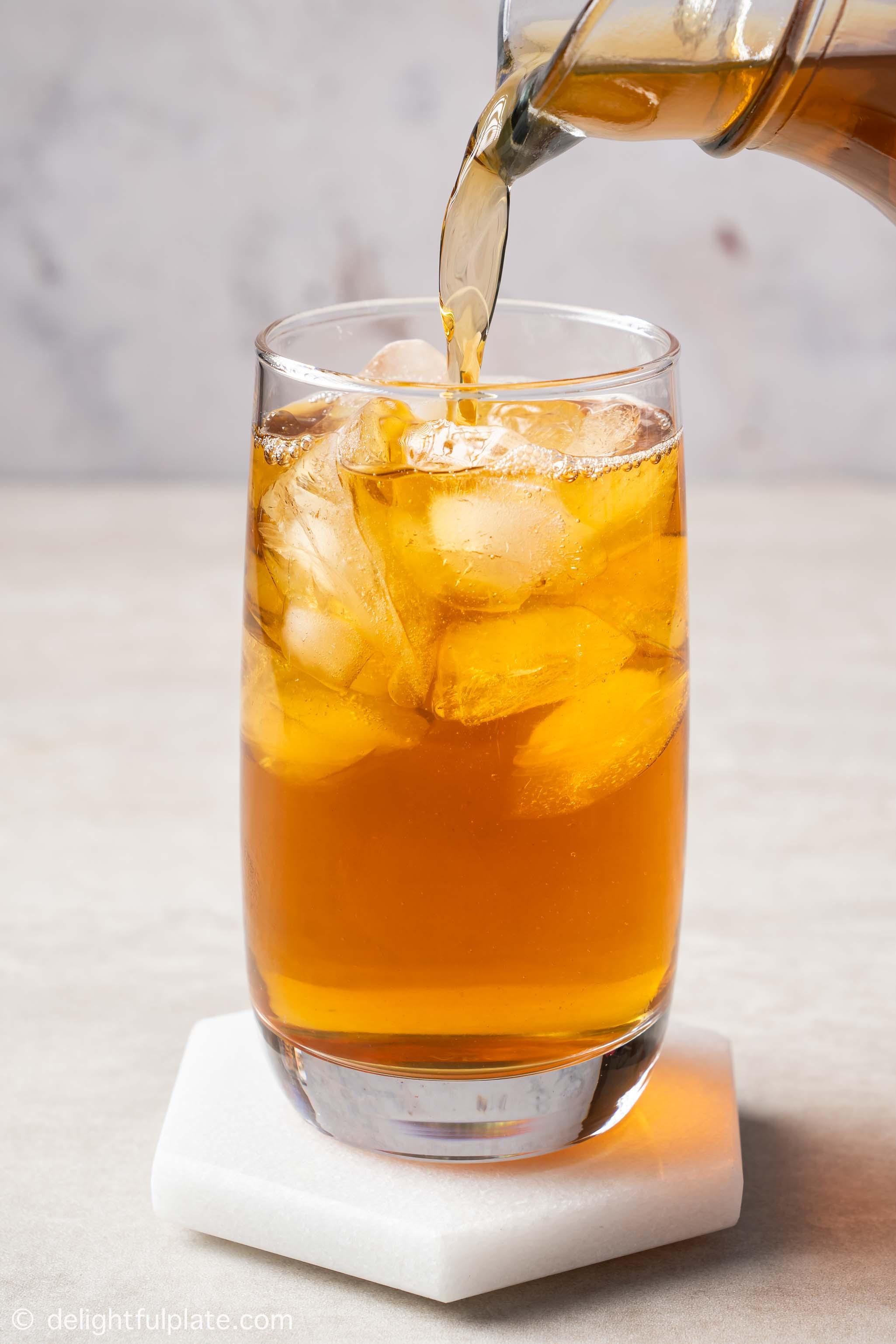 pouring winter melon tea into a glass