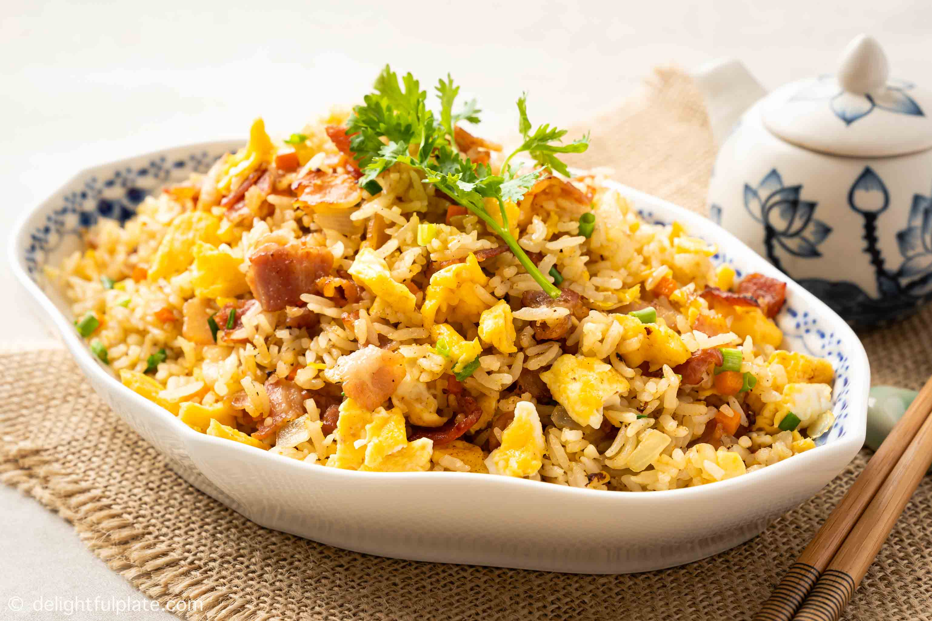 a plate of bacon fried rice